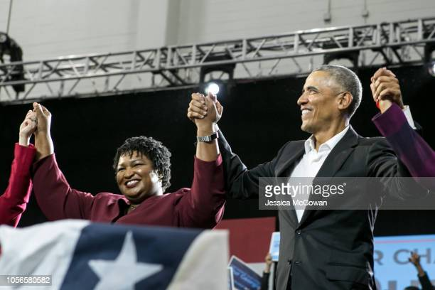 Former US President Barack Obama stands with Georgia Democratic Gubernatorial candidate Stacey Abrams during a campaign rally at Morehouse College on...