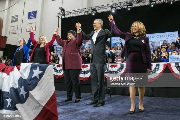 Former US President Barack Obama stands with Georgia Democratic candidates Carolyn Bourdeaux for CD07 Sarah Riggs Amico for Lieutenant Governor...