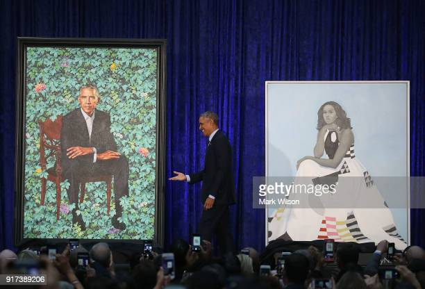 Former US President Barack Obama stands with his and former first lady Michelle Obama's newly unveiled portrait during a ceremony at the...
