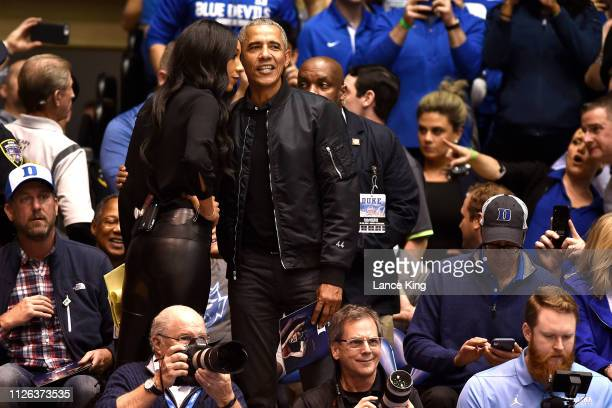 Former US President Barack Obama talks with ESPN analyst Maria Taylor while attending the game between the North Carolina Tar Heels and the Duke Blue...
