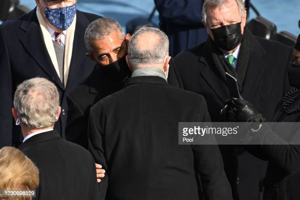 Former US President Barack Obama talks with Senate Majority leader Chuck Schumer during the 59th Presidential Inauguration at the U.S. Capitol on...