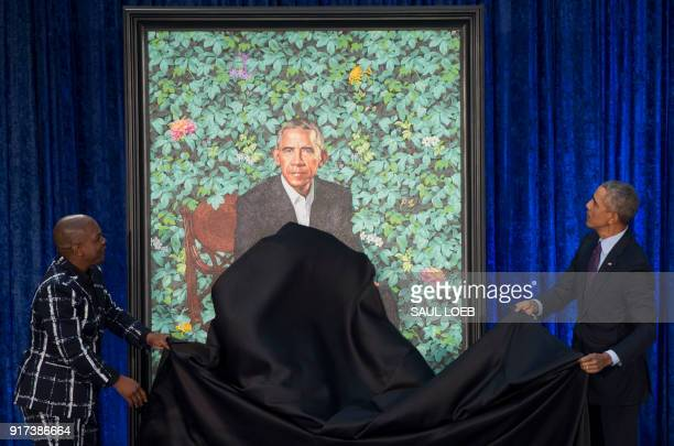 Former US President Barack Obama unveils his portrait alongside the portrait's artist, Kehinde Wiley, at the Smithsonian's National Portrait Gallery...