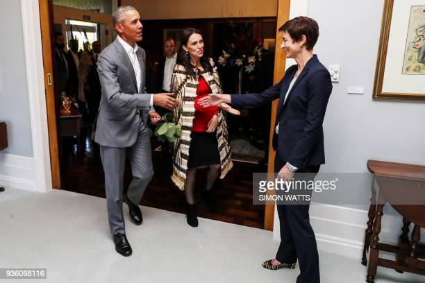 Former US president Barack Obama walks with New Zealand's Prime Minister Jacinda Ardern in Government House in Auckland on March 22 2018 Obama is...