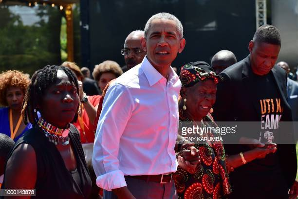 Former US President Barack Obama with his stepgrandmother Sarah and halfsister Auma arrive to unveil a plaque on July 16 2018 during the opening of...