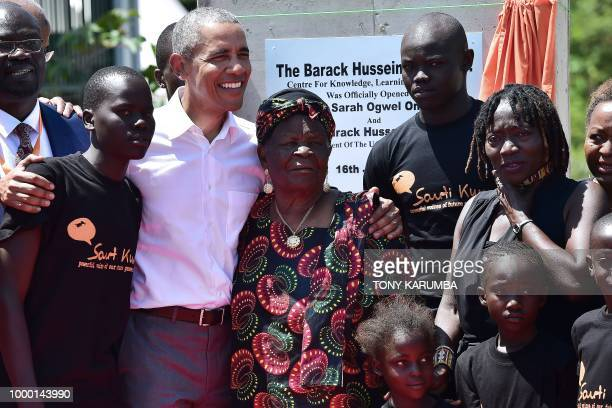TOPSHOT Former US President Barack Obama with his stepgrandmother Sarah and halfsister Auma arrive to unveil a plaque on July 16 2018 during the...