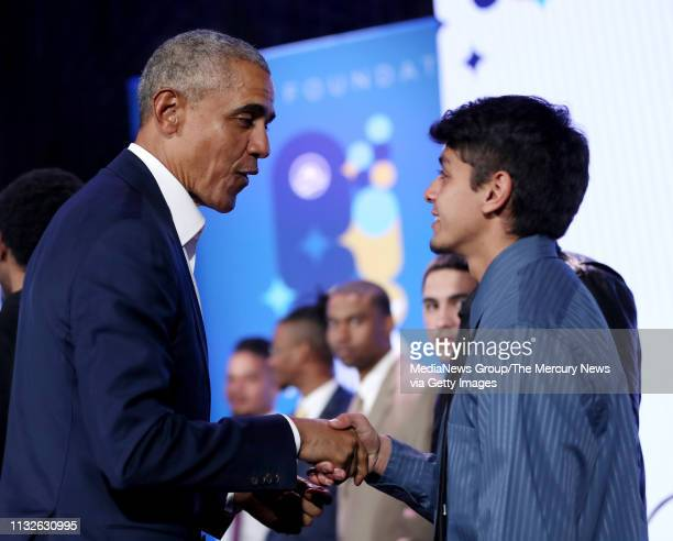 Former US President Barrack Obama greets a group of youth at the conclusion of the town hall with Golden State Warriors star Stephen Curry during the...