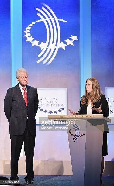 Former U.S. President Bill Clinton and daughter, vice chair of the Clinton Foundation Chelsea Clinton address the audience during the Opening Plenary...