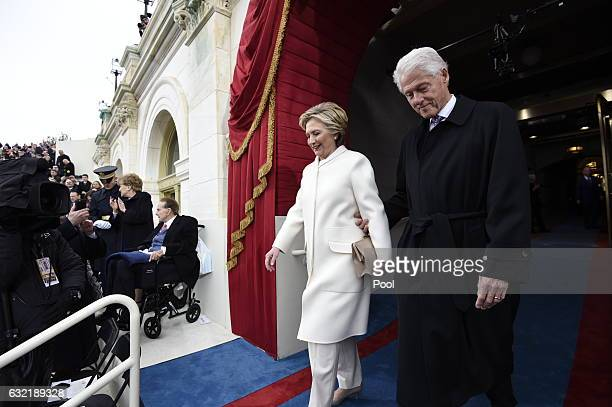 Former US President Bill Clinton and First Lady Hillary Clinton arrive for the Presidential Inauguration of Donald Trump at the US Capitol on January...