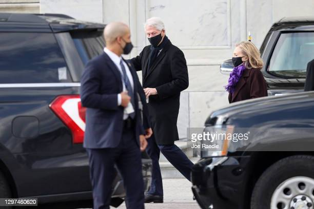 Former U.S. President Bill Clinton and former First Lady and former Secretary of State Hillary Clinton leave after the inauguration of U.S....