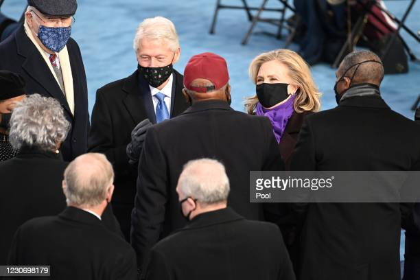 Former US President Bill Clinton and former US Secretary of State Hillary Clinton attend the 59th Presidential Inauguration at the U.S. Capitol on...