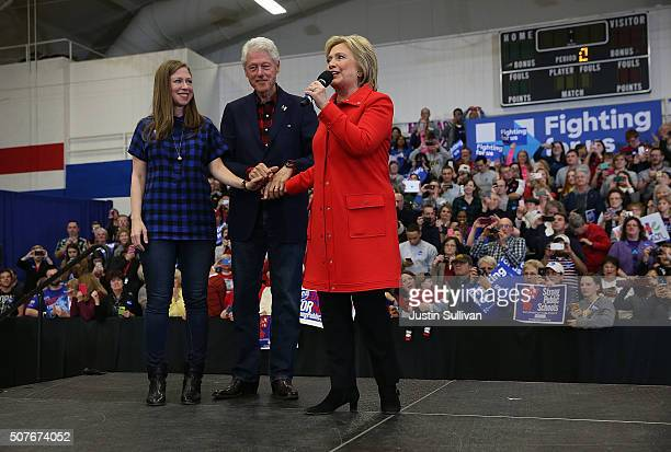 Former US president Bill Clinton and his daughter Chelsea Clinton look on as democratic presidential candidate former Secretary of State Hillary...