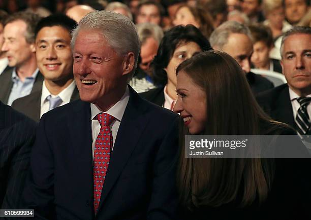 Former US president Bill Clinton and his daughter Chelsea Clinton look on before the start of the first presidential debate with Democratic...