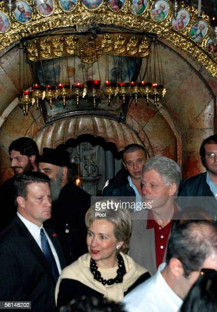 Former US President Bill Clinton and his wife US Senator Hillary Rodham Clinton leave the Tomb of Christ inside the Church of the Holy Sepulchre in...