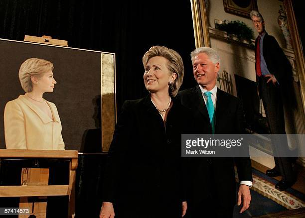 Former US President Bill Clinton and his wife US Senator Hillary Clinton stand near their portraits during an unveiling ceremony at the Smithsonian...