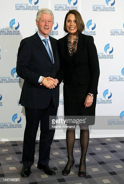 Former US President Bill Clinton and Linda Lockhart attend the third day of the CGDC Annual Meeting on May 18 2012 in Vienna Austria The Center for...