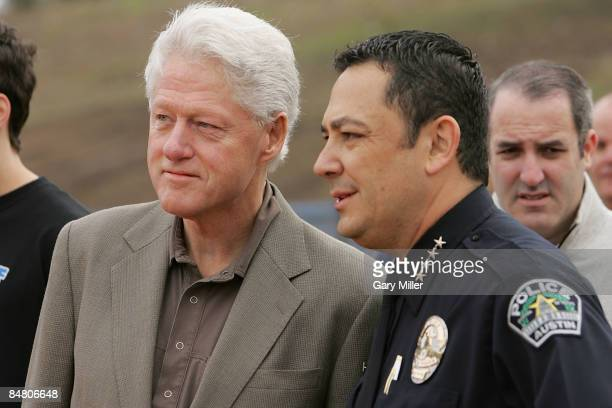 Former U.S. President Bill Clinton and Police Chief Art Acevedo at the service project closing the Second Clinton Global Initiative University at...