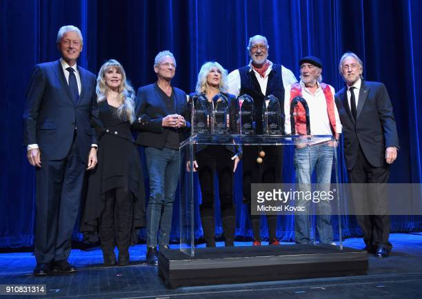 Former US President Bill Clinton and Recording Academy and MusiCares President/CEO Neil Portnow present the MusiCares Person of the Year award to...