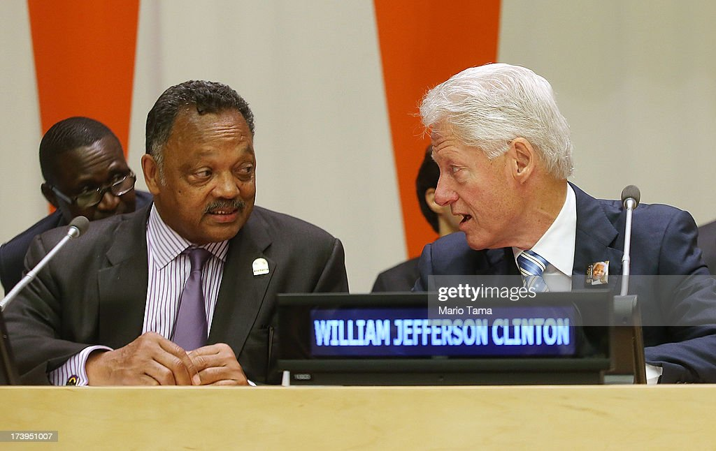 Former U.S. President Bill Clinton (R) and Rev. Jesse Jackson speak before the start of an informal meeting of the plenary of the General Assembly, on the commemoration of the Nelson Mandela International Day, at U.N. headquarters on July 18, 2013 in New York City. South Africa's first black president and anti-apartheid leader turns 95 today on his 41st day in the hospital.