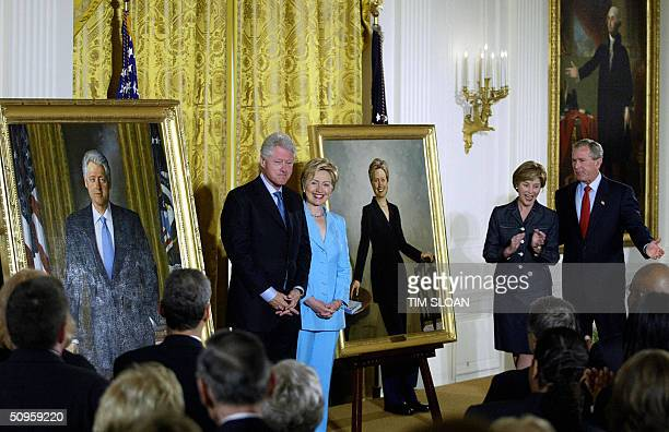 Former US President Bill Clinton and Senator Hillary Clinton stand by their offical White House portraits during the unveiling event hosted by...