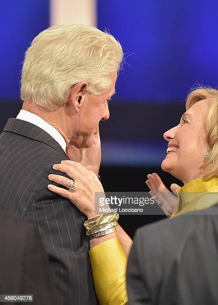"""Former U.S. President Bill Clinton and wife, Former US Secretary of State Hillary Clinton attend the Closing Plenary Session: """"Aiming for the Moon..."""