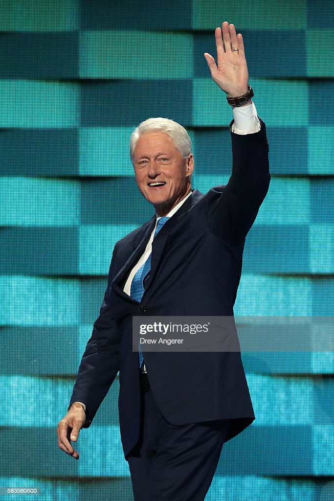 Former US President Bill Clinton arrives on stage to deliver remarks on the second day of the Democratic National Convention at the Wells Fargo Center, July 26, 2016 in Philadelphia, Pennsylvania. Democratic presidential candidate Hillary Clinton received the number of votes needed to secure the party's nomination. An estimated 50,000 people are expected in Philadelphia, including hundreds of protesters and members of the media. The four-day Democratic National Convention kicked off July 25.