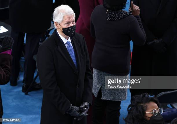 Former U.S. President Bill Clinton arrives to the inauguration of U.S. President-elect Joe Biden on the West Front of the U.S. Capitol on January 20,...