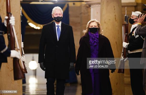 Former US President Bill Clinton arrives with former Secretary of State Hillary Clinton before the inauguration of President-elect Joe Biden as the...