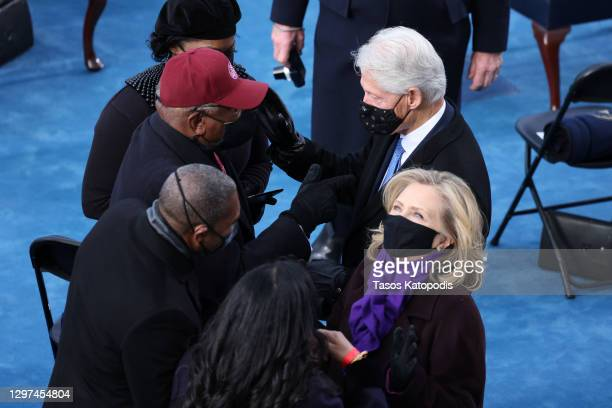 Former U.S. President Bill Clinton arrives with former Secretary of State Hillary Clinton to the inauguration of U.S. President-elect Joe Biden on...