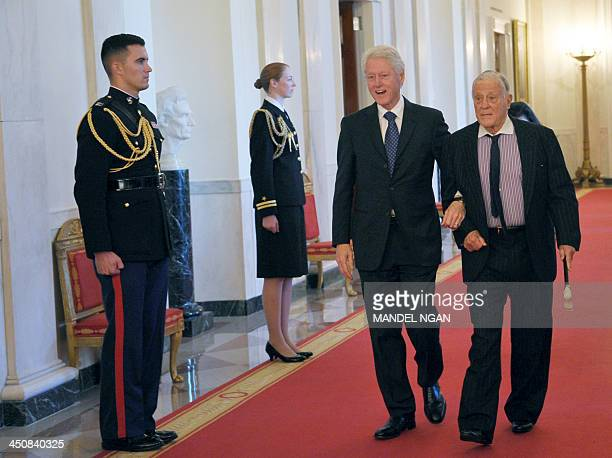 Former US president Bill Clinton arrives with former Washington Post executive editor Ben Bradlee for the Presidential Medal of Freedom presentation...