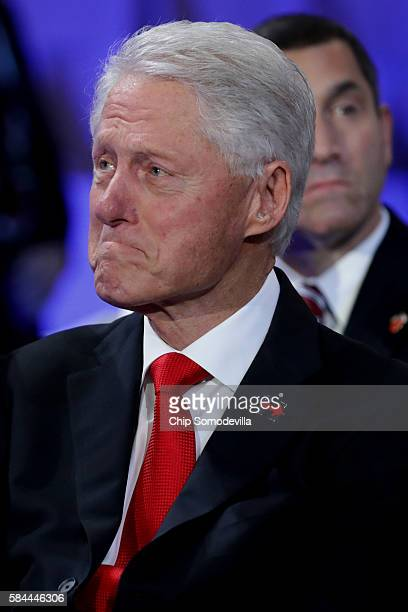 Former US President Bill Clinton becomes emotional as he listens to his daughter Chelsea Clinton introduce her mother Democratic presidential nominee...