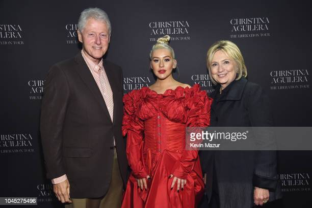 Former US President Bill Clinton Christina Aguilera and former US Secretary of State Hillary Clinton pose backstage during Christina Aguilera The...
