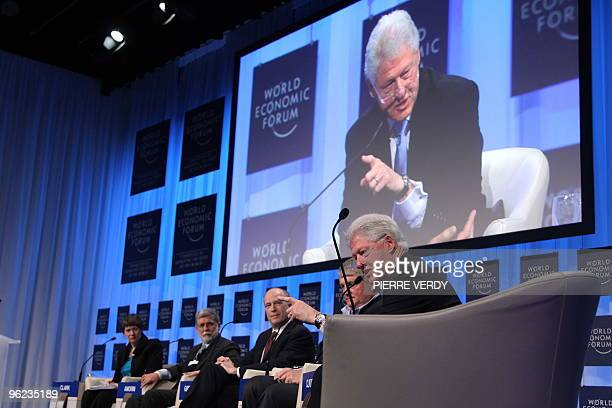 Former US president Bill Clinton delivers a speech as he is seen on a screen during the Special Session on Haiti on the second day of the World...