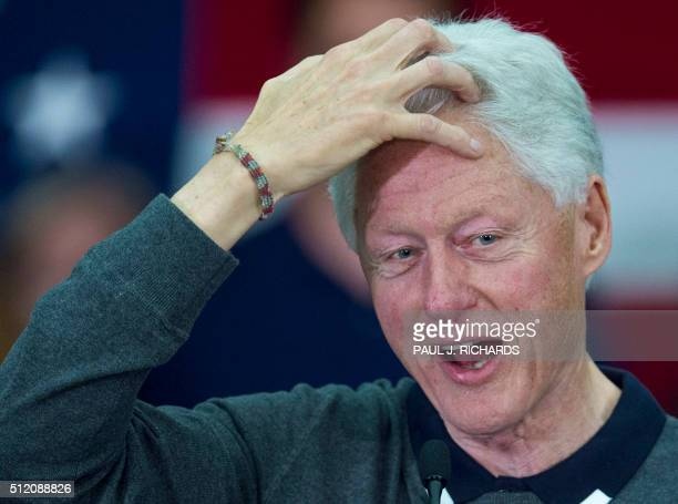 Former US President Bill Clinton delivers remarks as he campaigns for his wife Democratic Presidential hopeful and former US Secretary of State...