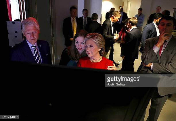 Former US President Bill Clinton Democratic presidential nominee former Secretary of State Hillary Clinton and their daughter Chelsea Clinton watch...