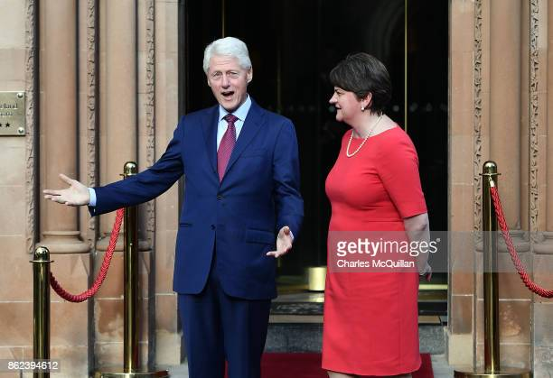 Former US President Bill Clinton gestures as he stands with DUP leader Arlene Foster at the Culloden Hotel following a private meeting on October 17...