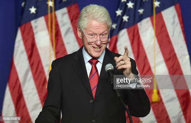 Former US President Bill Clinton gestures while speaking in show of support of California Democrats during during a Get Out The Vote rally in Oxnard...