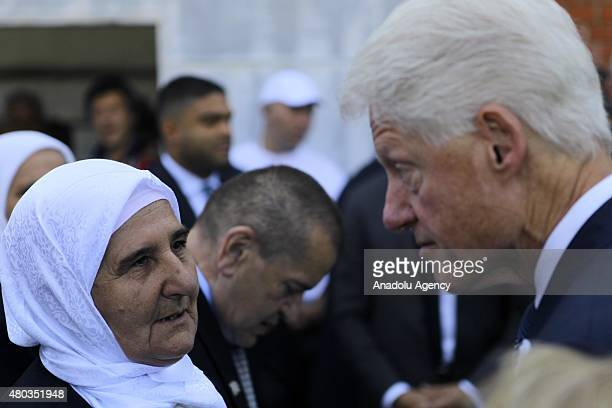 Former US President Bill Clinton greeted by Munira Subasic the president of the Mothers of Srebrenica Association as he arrives at Potocari Memorial...