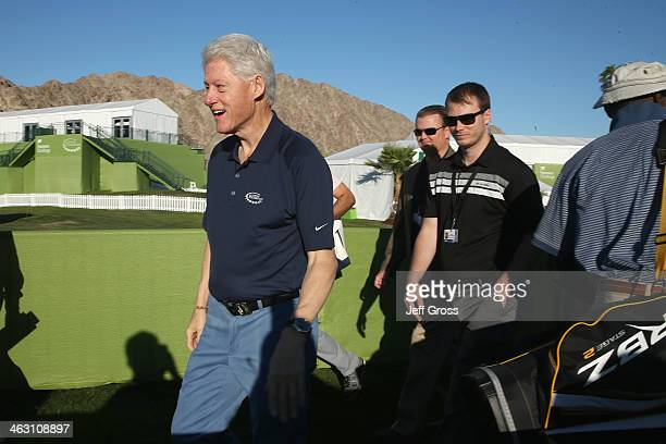 Former US President Bill Clinton greets attendants of the Humana Challenge in partnership with the Clinton Foundation before the first round at PGA...
