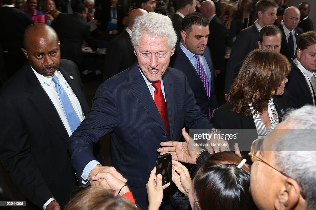 Former U.S. President Bill Clinton greets conference attendees as he leaves the 20th International AIDS Conference at The Melbourne Convention and Exhibition Centre on July 23, 2014 in Melbourne, Australia. Several researchers, activists and health workers due to attend the conference were killed enroute in the Malaysian Airlines plane MH17 shot down over Eastern Ukraine.