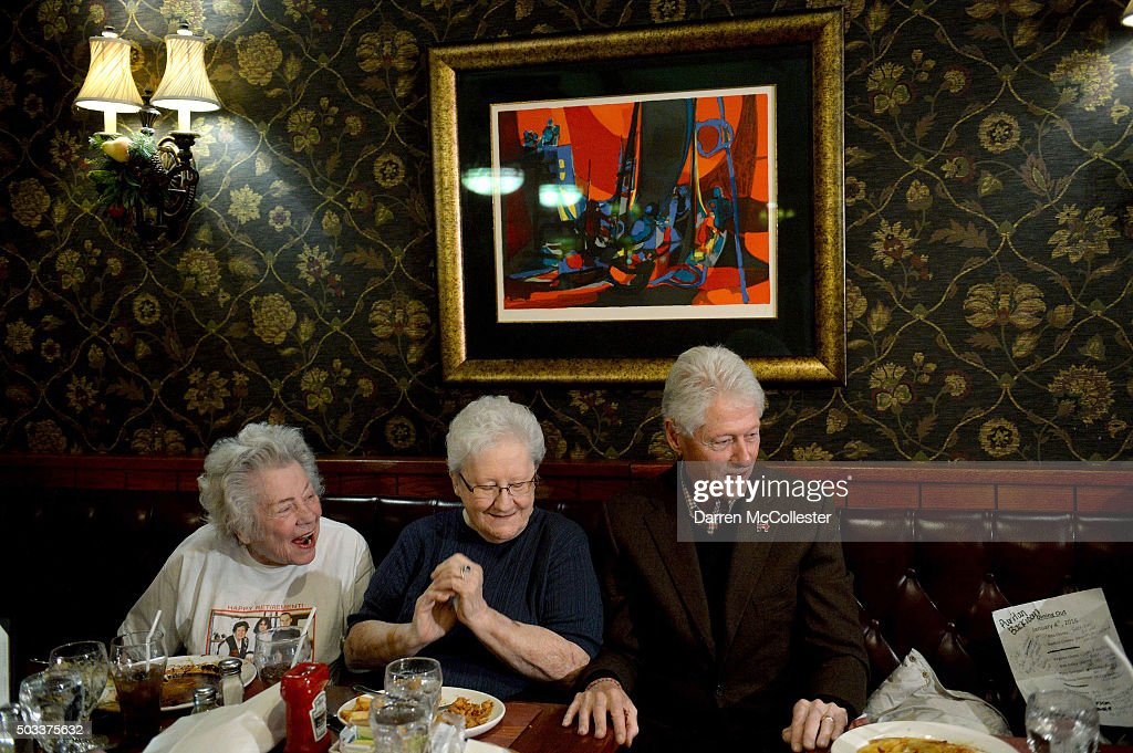 Former U.S. President Bill Clinton greets diners at the Puritan Backroom January 4, 2016 in Manchester, New Hampshire. Bill Clinton spent the day campaigning for his wife, Democratic presidential candidate Hillary Clinton.