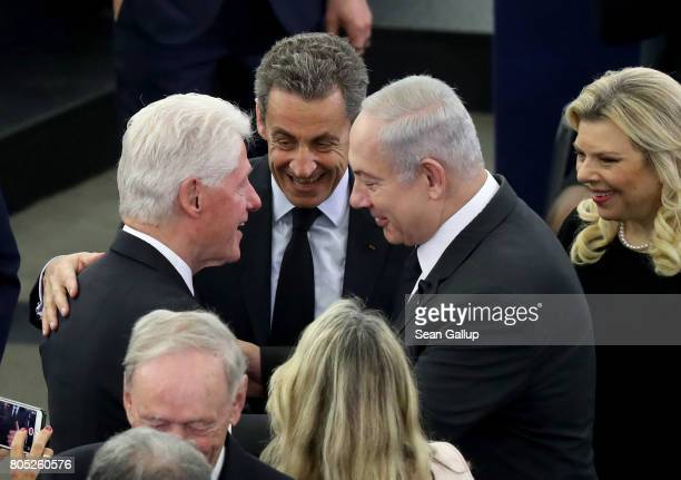 Former US President Bill Clinton greets Israeli Prime Minister Benjamin Netanyahu and his wife Sara as French President Nicolas Sarkozy looks on...