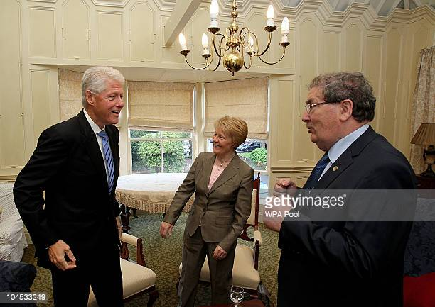 Former US President Bill Clinton greets John Hume former leader of the SDLP and his wife Pat in the Beech Hill Hotel on September 29 2010 in...