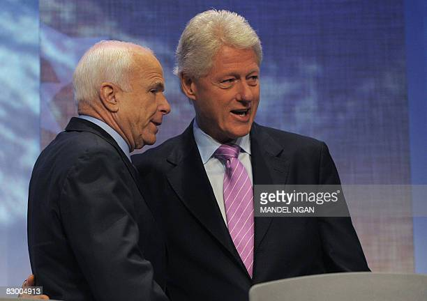 Former US president Bill Clinton greets Republican presidential nominee John McCain before McCain's address to the Clinton Global Initiative on...