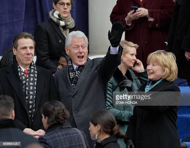 Former US President Bill Clinton his wife Hillary Rodham Clinton and New York Governor Andrew Cupomo arrive for the inauguration of New York City...