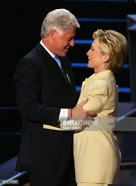 Former US President Bill Clinton hugs his wife Senator Hillary Clinton of New York after she introduced him on opening night of the Democratic...