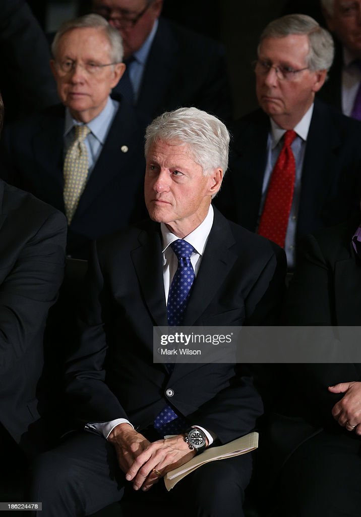 Former U.S. President Bill Clinton (C) is flanked by Senate Majority Leader Harry Reid (D-NV) (L) and Senate Minority Leader Mitch McConnell (R-KY) during a memorial service for former House Speaker Tom Foley (D-WA), at the U.S. Capitol, October 29, 2013 in Washington, DC President Obama and members of Congress gathered for a Congressional Memorial Service celebrating the life of former House Speaker Tom Foley (D-WA) who died on October 18.