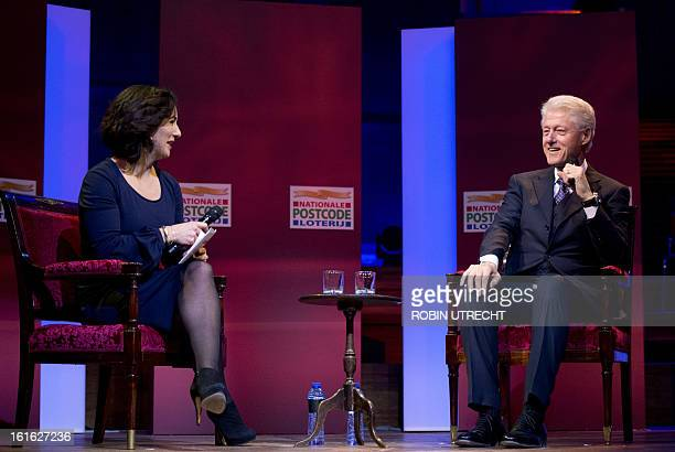 Former US president Bill Clinton is interviewed by dutch former green party leader Femke Halsema during the Goed Geld Gala organized by a Dutch...