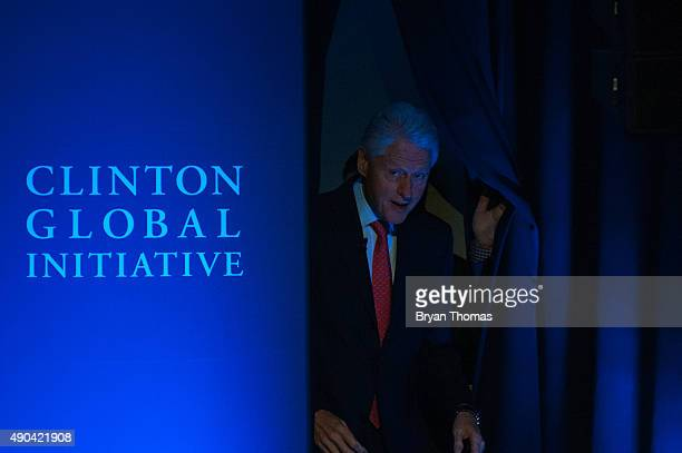 Former US President Bill Clinton is introduced to the crowd during the Clinton Global Initiative Annual Meeting at the Sheraton Hotel and Towers on...