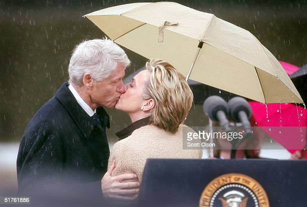 Former US President Bill Clinton kisses his wife US Senator Hillary Rodham Clinton after she introduced him at the dedication of the William J...