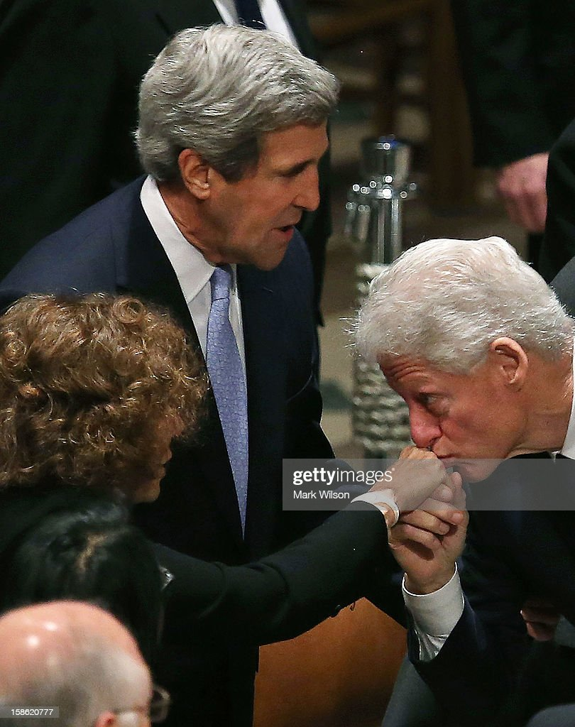 Former U.S. President Bill Clinton (R) kisses the hand of Teresa Heinz Kerry (L) as Sen. John Kerry (D-MA) stands nearby during the funeral service for the late Sen. Daniel Inouye (D-HI) at the National Cathedral on December 21, 2012 in Washington, DC. Later today President Obama is expected to nominate Senator Kerry as Secretary of State to replace Secretary of State Hillary Clinton, who will not serve a second term.